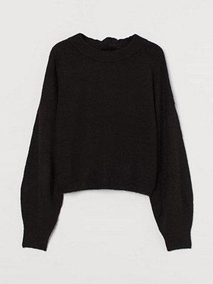 H&M Stickad tröja med knytband svart