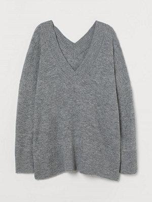 H&M H & M+ V-ringad tröja i ullmix grå