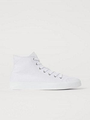 H&M Ankelhöga sneakers i canvas vit