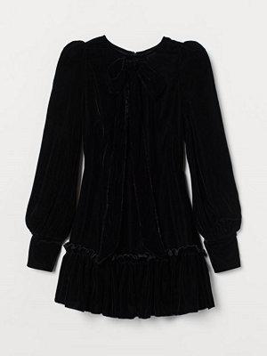 H&M Sammetsklänning med rosett svart