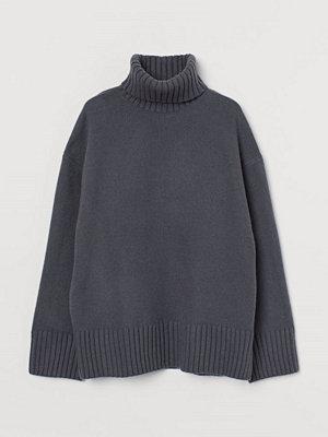 H&M Stickad polotröja blå
