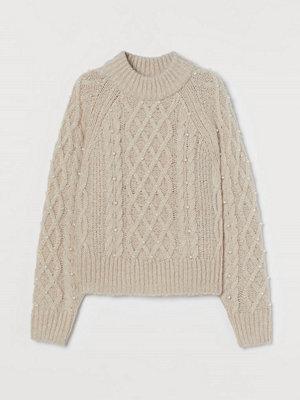 H&M Kabelstickad tröja med pärlor beige
