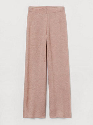H&M beige byxor Stickad byxa i ullmix rosa