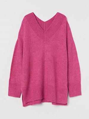 H&M V-ringad tröja i ullmix rosa