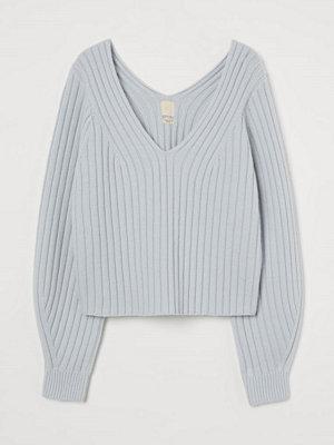 H&M Ribbstickad tröja i merinomix grå