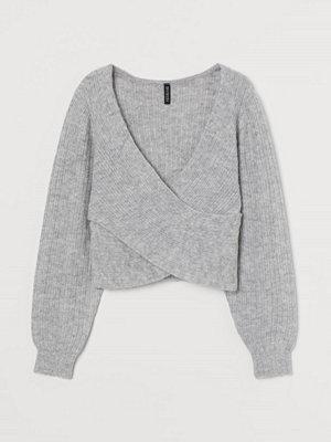 H&M Stickad tröja med omlott grå
