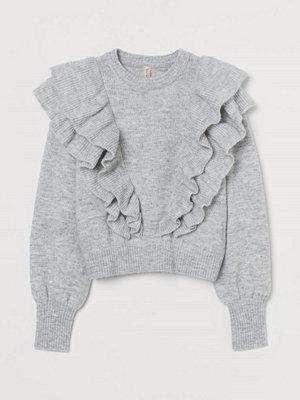 H&M Stickad tröja med volanger grå