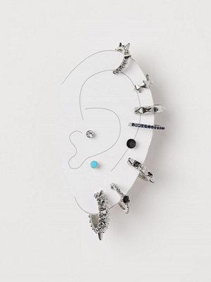 H&M 10-pack örhängen och cuffs silver