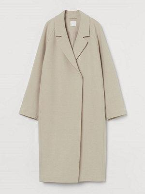 H&M Vadlång kappa beige