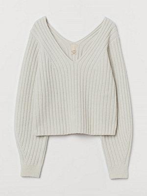 H&M Ribbstickad tröja i merinomix vit