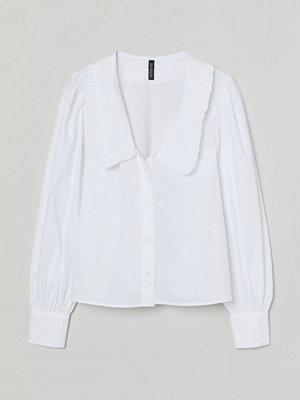 H&M Blus med volangkrage vit