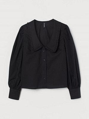 H&M Blus med volangkrage svart