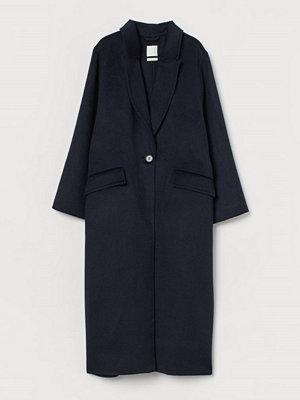 H&M Oversized kappa i ullmix blå