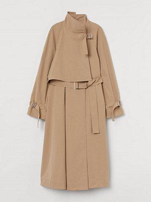 H&M Utställd trenchcoat beige