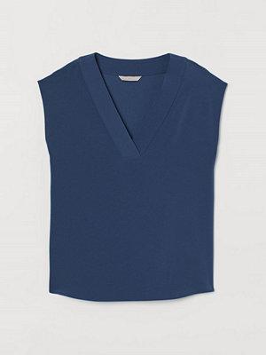 H&M V-ringad blus blå