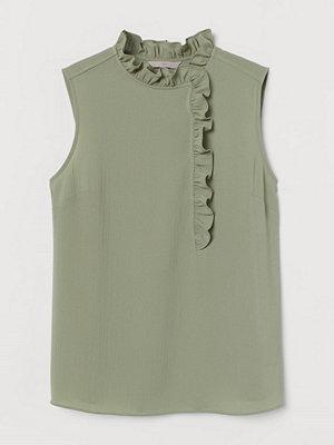 H&M Ärmlös volangblus grön