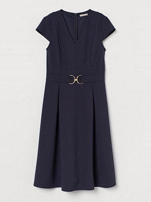 H&M Klänning med holkärm blå