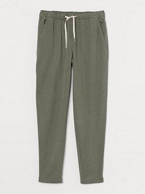 H&M omönstrade byxor Pull on-byxa i lyocellmix grön