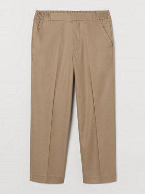 H&M Kostymbyxa beige