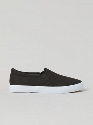 H&M Slip on-sneakers svart