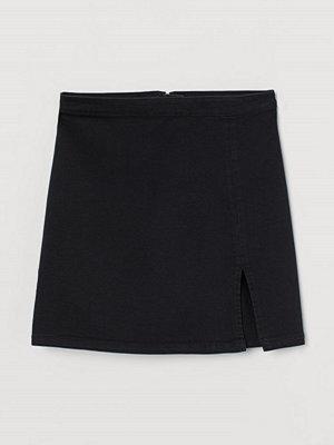 H&M Jeanskjol med slits svart