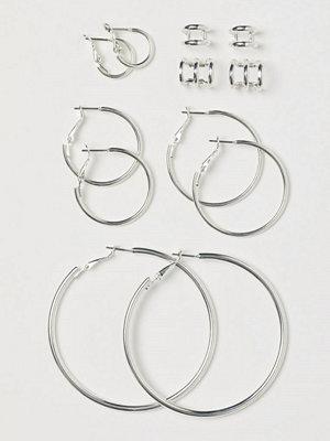 H&M Runda örhängen och earcuffs silver