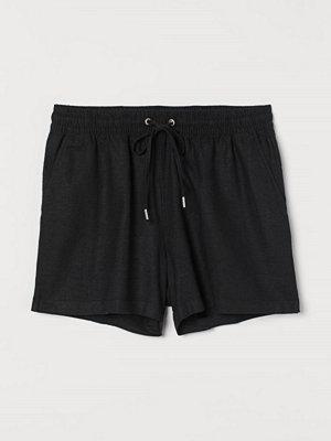 H&M Shorts i linmix svart