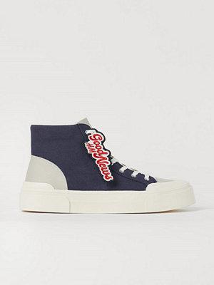 H&M Ankelhöga sneakers i canvas blå