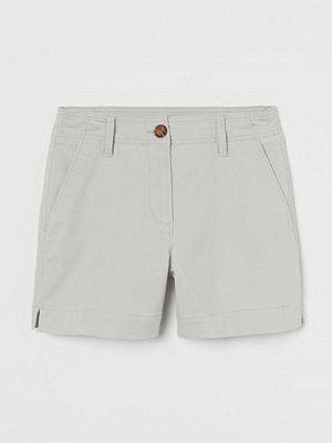 H&M Shorts i bomullstwill grön