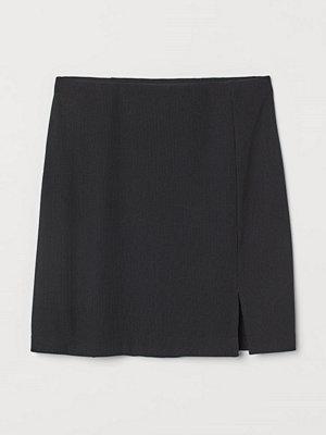 H&M Figurnära trikåkjol svart