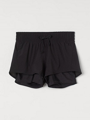 Shorts & kortbyxor - H&M MAMA Dubblerade löparshorts svart