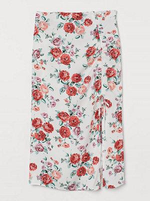 H&M Kjol med dragsko vit