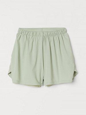 H&M Dubblerade löparshorts grön