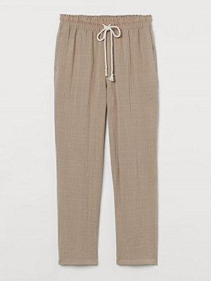 H&M omönstrade byxor Pull on-byxa i viskosmix brun