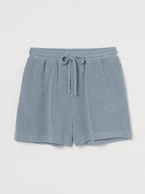 H&M Stickade shorts blå