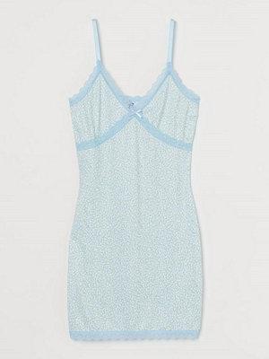 H&M Ribbad klänning med spets vit