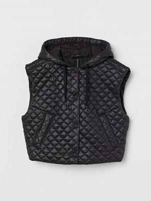 H&M Quiltad väst med huva svart