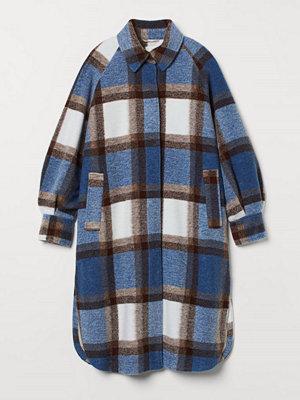 H&M Oversized kappa blå