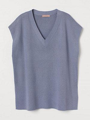 H&M V-ringad slipover blå
