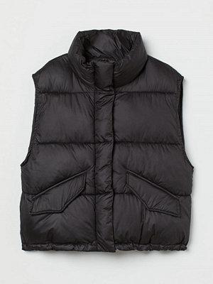 H&M Vadderad väst med ståkrage svart