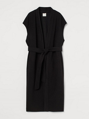 H&M Ärmlös kappa svart