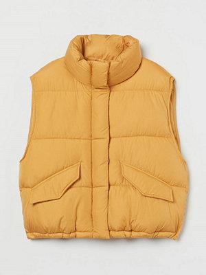 H&M Vadderad väst med ståkrage gul