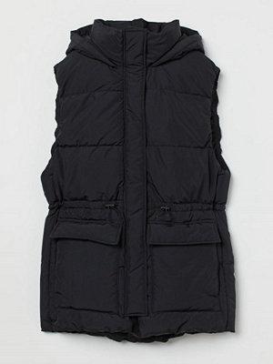 H&M Vadderad väst med huva svart