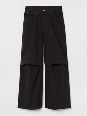 H&M Oversized cut out-jeans svart