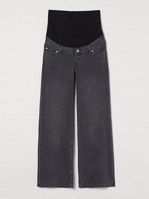 H&M MAMA Wide High Jeans grå