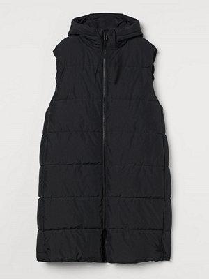 H&M H & M+ Vadderad väst med huva svart