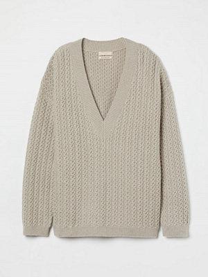 H&M Kabelstickad tröja i ull beige