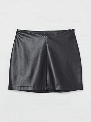 H&M Kjol i fuskläder svart