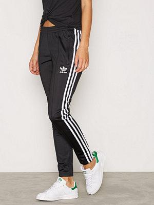 Adidas Originals svarta byxor Sst Tp Black