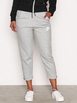 Nike ljusgrå byxor NSW AV15 Pant Snkr Mörk Grå